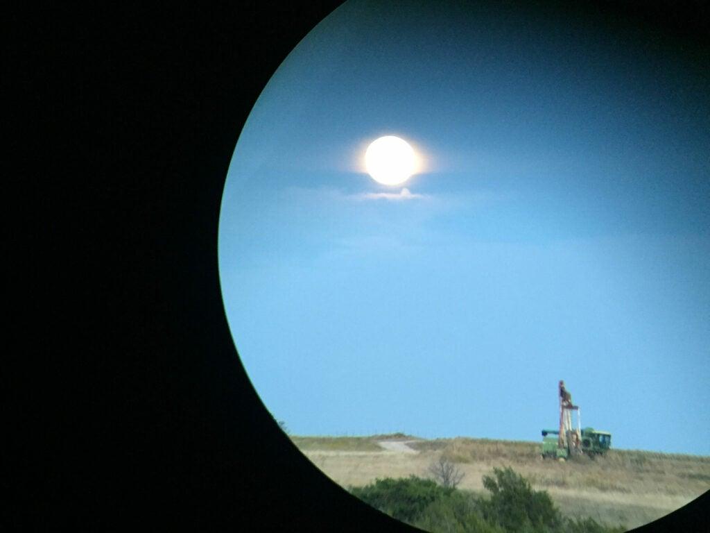 full moon over oil rig