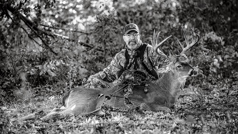 Grant woods with a whitetail buck