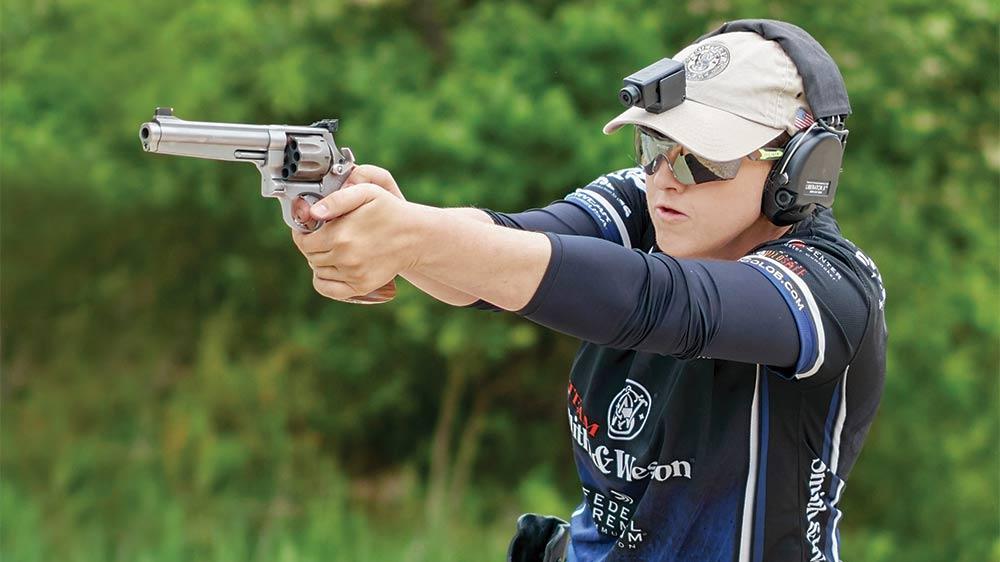 Julie Golob firing a handgun