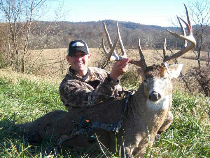 young corey memering with whitetail buck