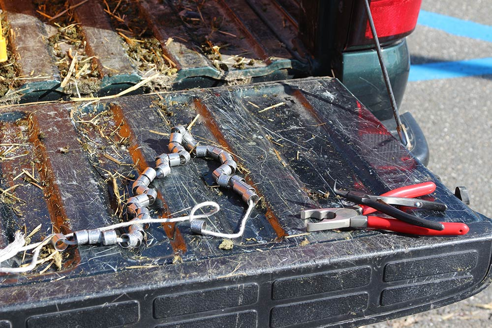 pair of pliers on a truck tailgate