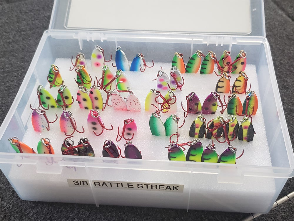 clear tackle box full of spoon lures