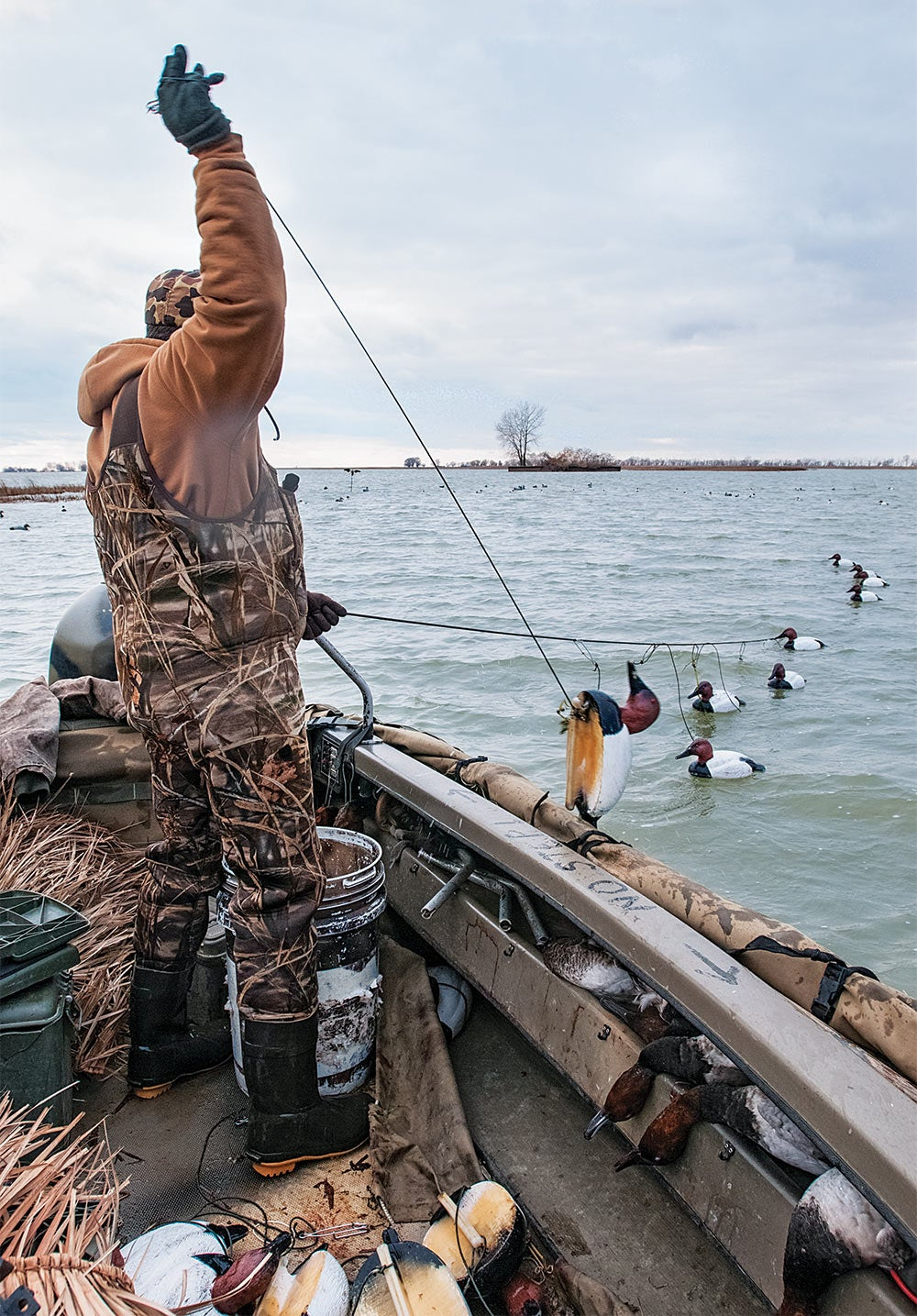 waterfowl hunter setting out a decoy spread