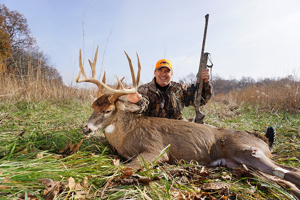 bruce lewis next to giant buck