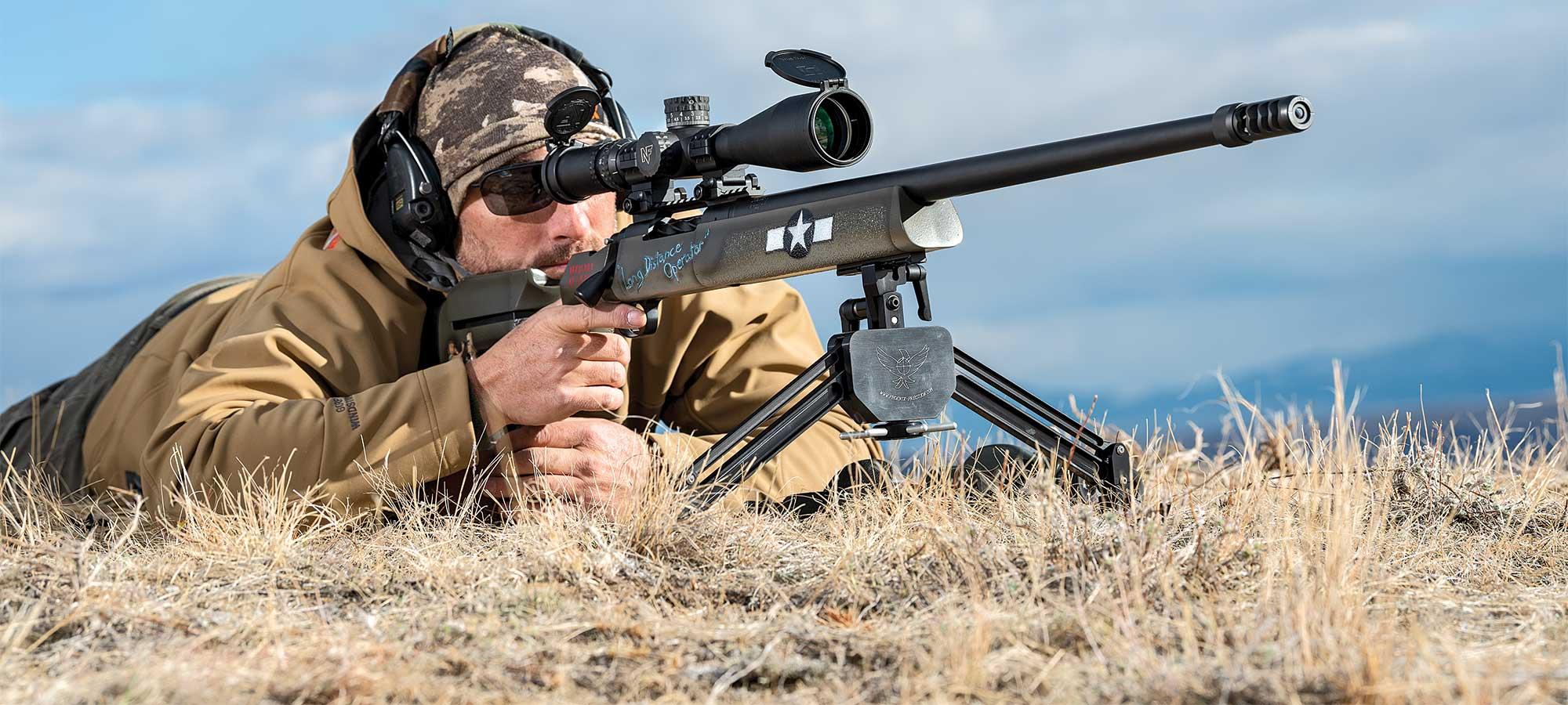 shooter aiming long range rifle