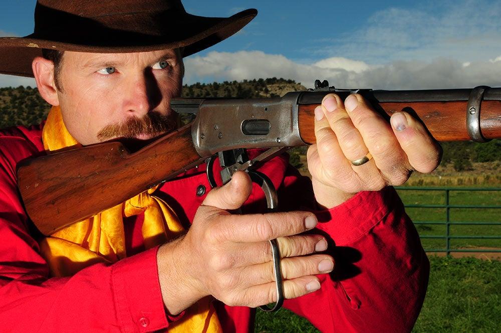 Aram von Benedikt aiming an all-purpose rifle