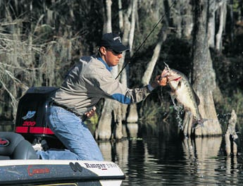 Use heavy, metal lures to get down deep for winter bass