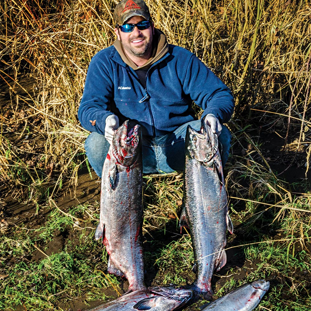 jon martin holding two oregon salmon