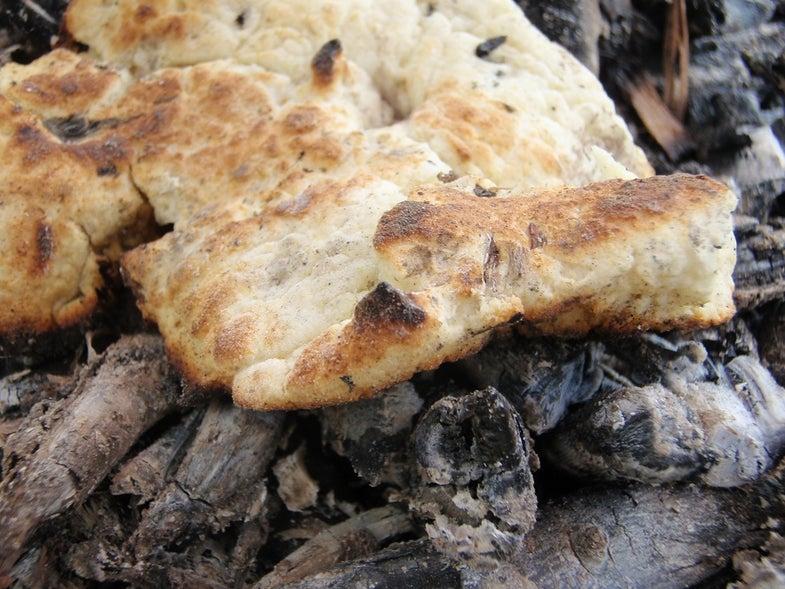 bread cooking on coals