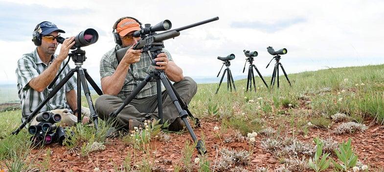 two hunters testing optics scopes and binoculars