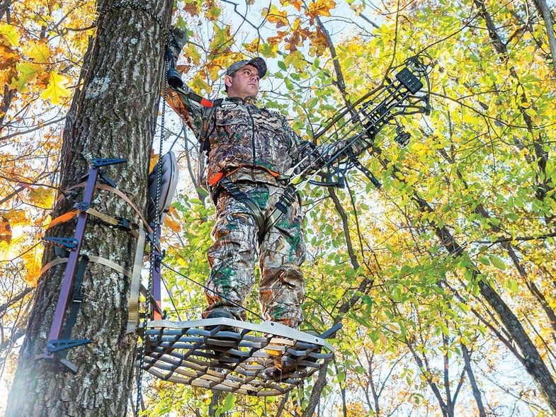 Iowa bowhunter in treestand during October