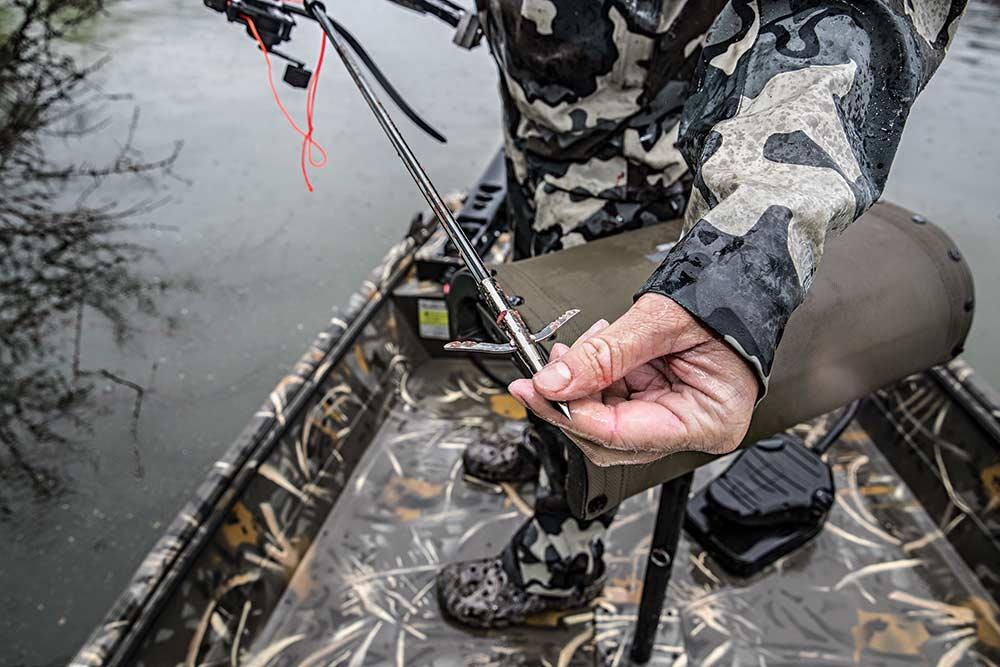 will brantley prepares a broadhead for bowfishing