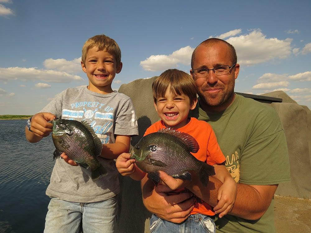father and sons fishing bluegills