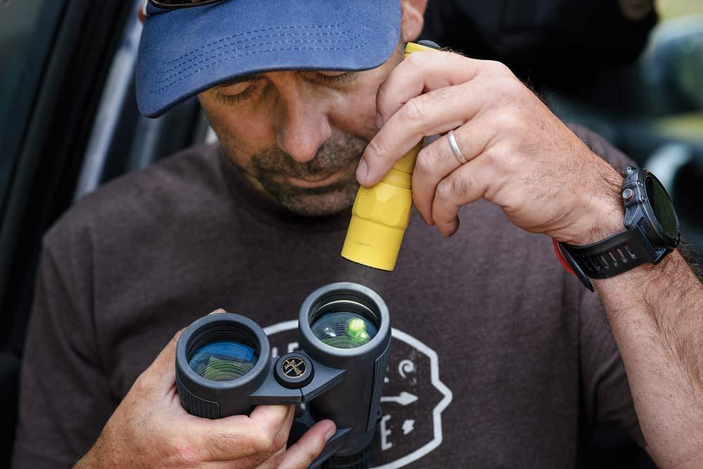 hunter checking binoculars