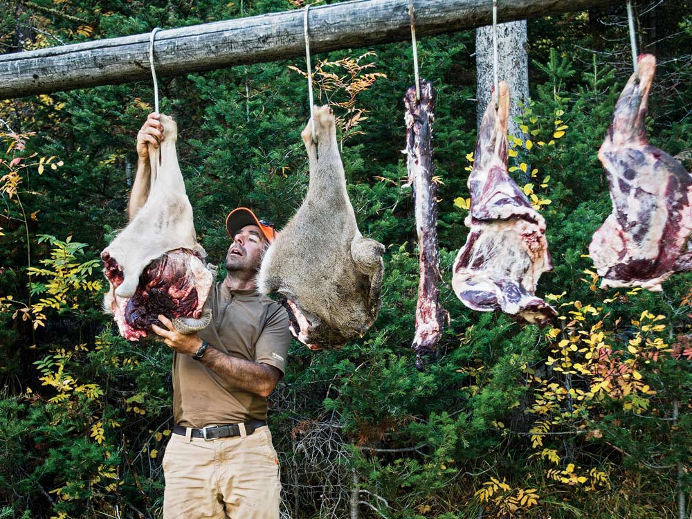 hanging deer meat at a camp
