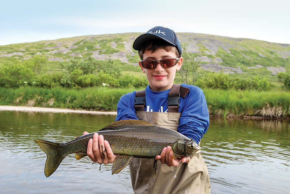 young boy with grayling