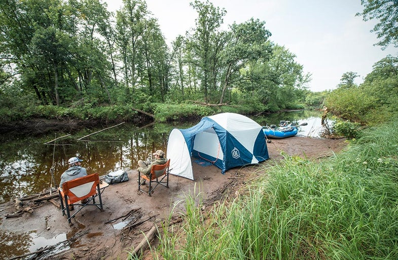 ol guide life bunk house tent on river shore