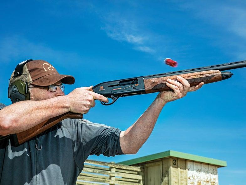 man firing a beretta a300 outlander shotgun