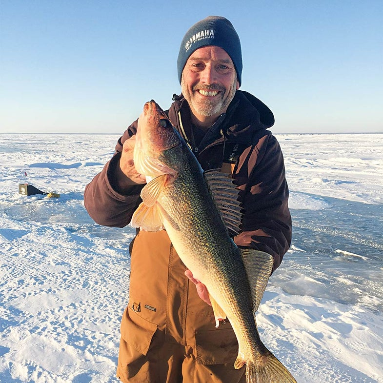 Ross Grothe with a tip-up-caught- Mille Lacs walleye