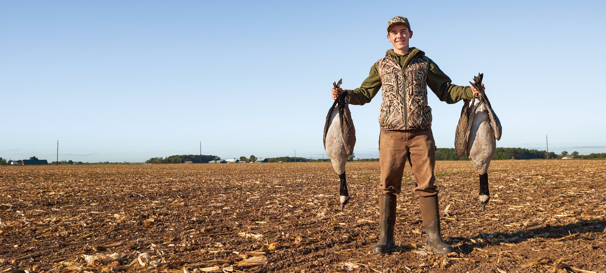 young geese hunter in field