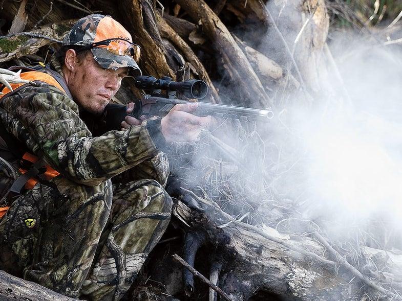 Hunter firing a muzzleloader