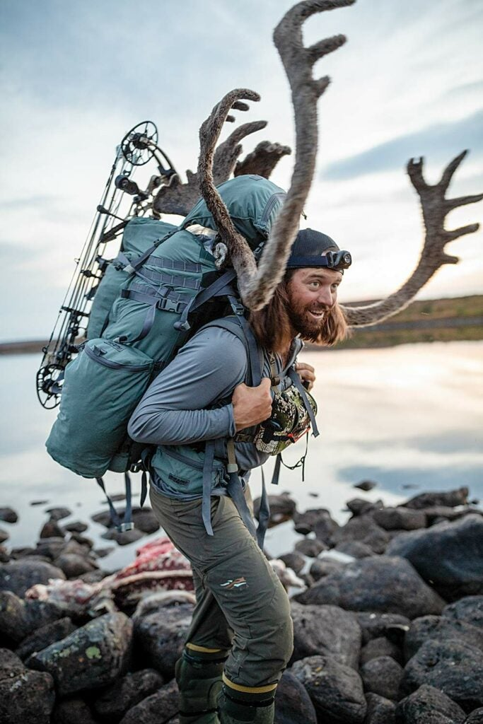 aaron hitchens hauling a packed out caribou