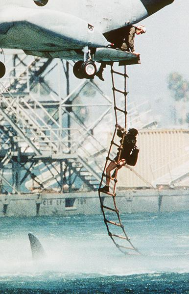 The Real Version of the Soldier Dangling From Helicopter Over Shark Photo