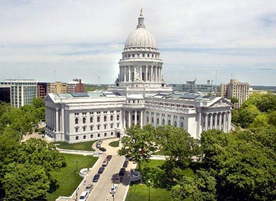 In WI, open-carry means openly harried