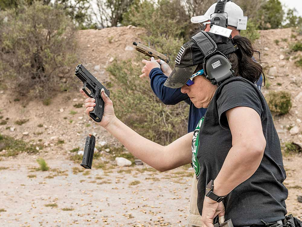 Suzanne Rickabaugh works on her reloads during a class at Gunsite.