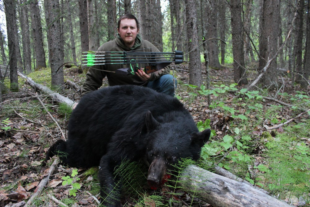 hunter with black bear