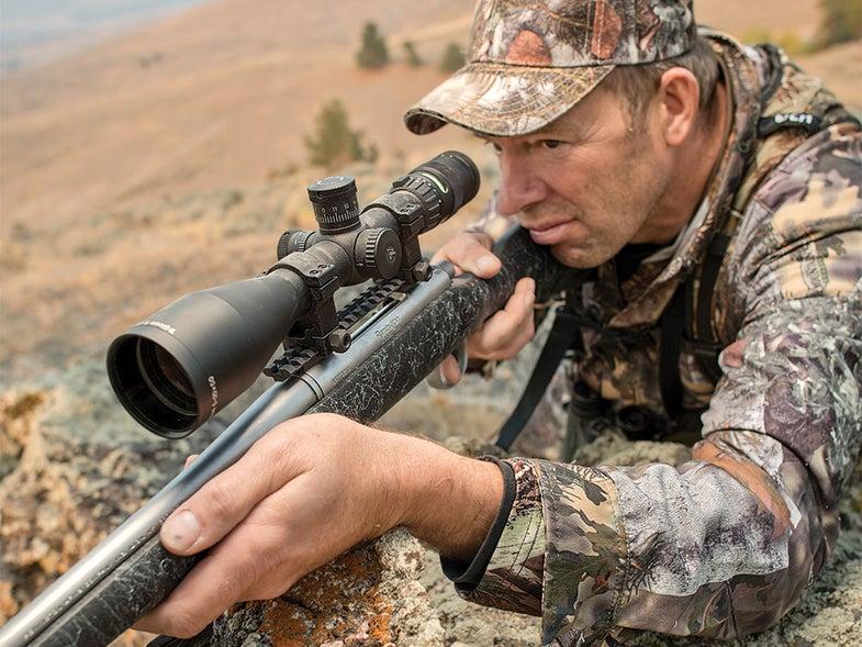 a hunter aiming a rifle