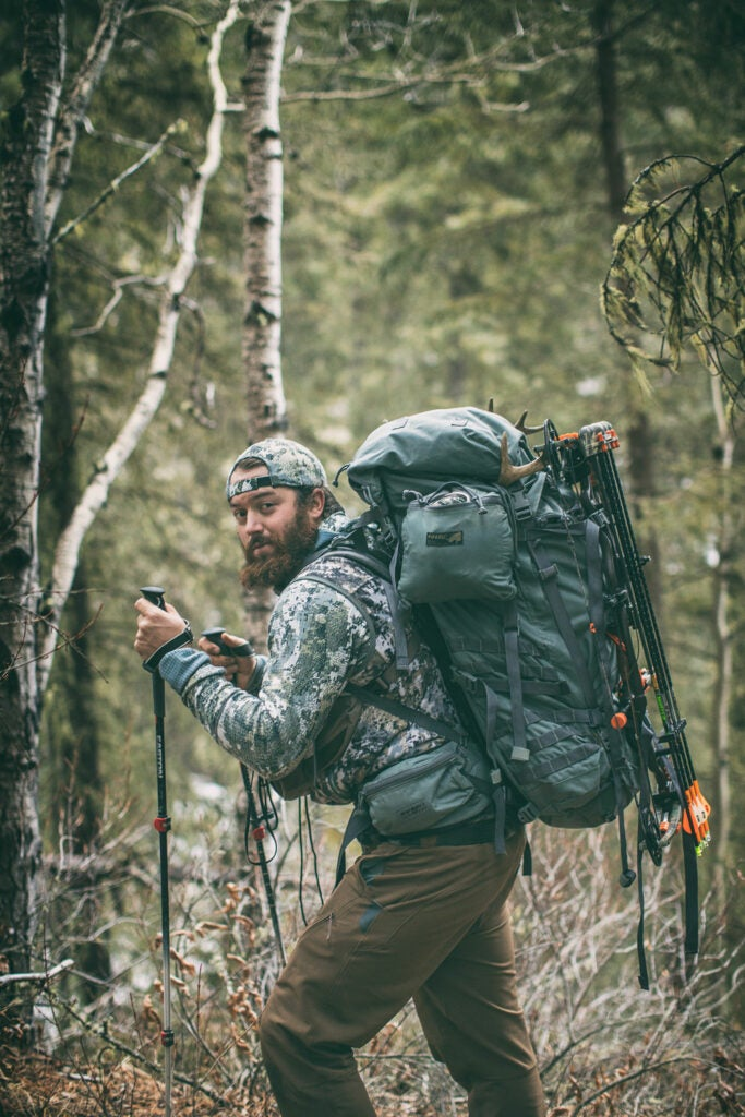 bowhunter packs out meat