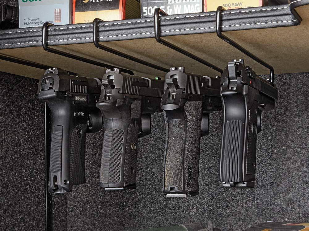 Under shelf pistol hangers
