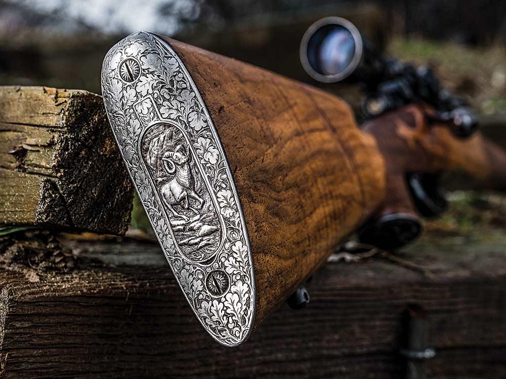 engraved steel ram rifle butt
