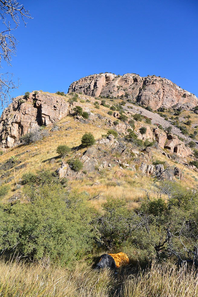 A campsite against a hilly landscape