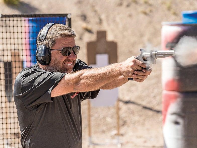 Man shooting a hangun during ammo test