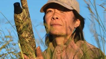 laurel holding shotgun hunting turkey