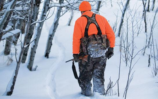 deer hunter tracking snow