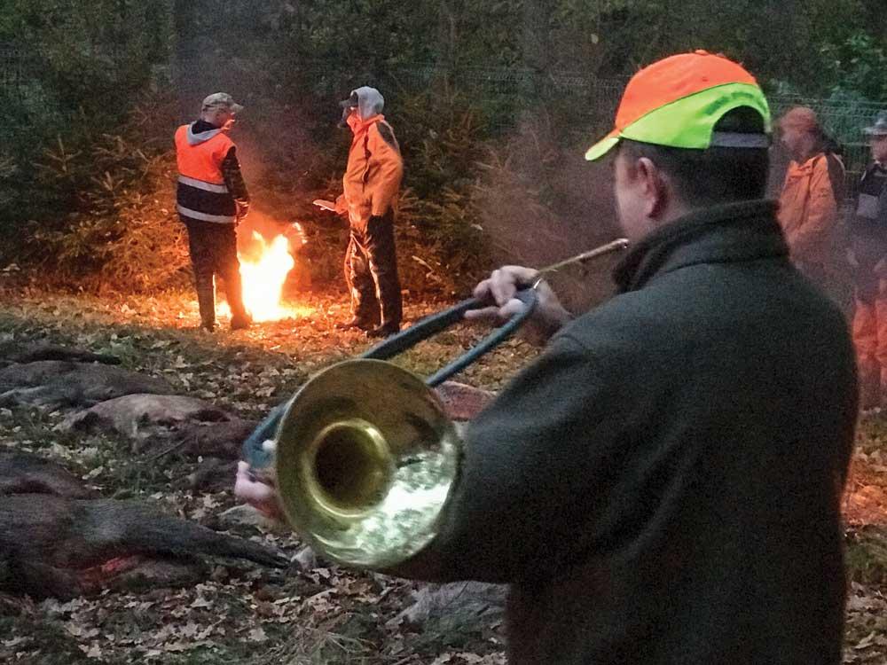 hunter playing horn