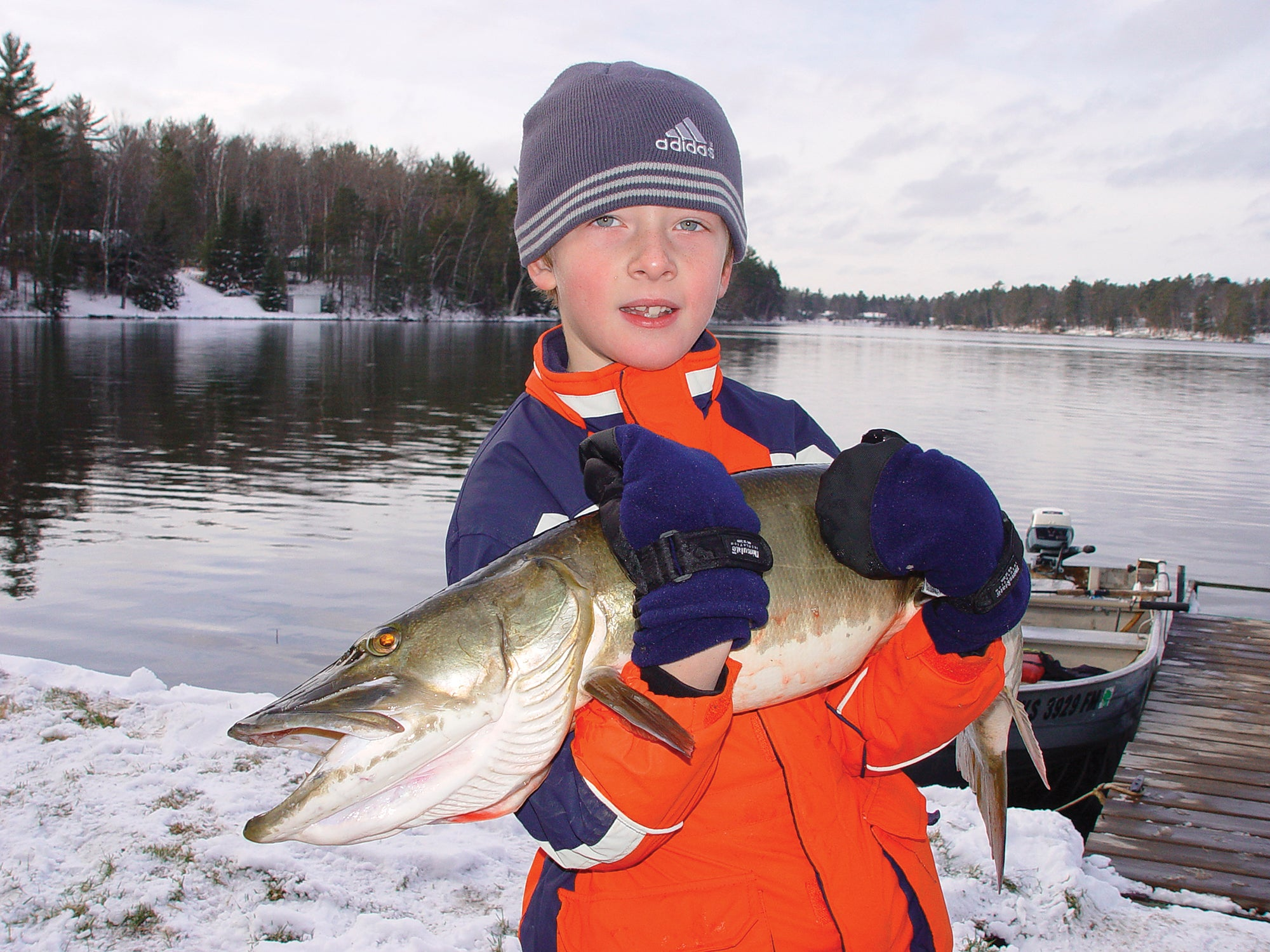 kid with shore-caught muskie