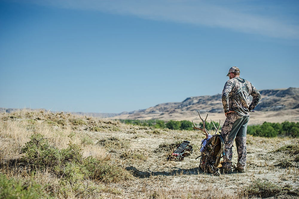 hunter standing near packed mule deer milk river alberta