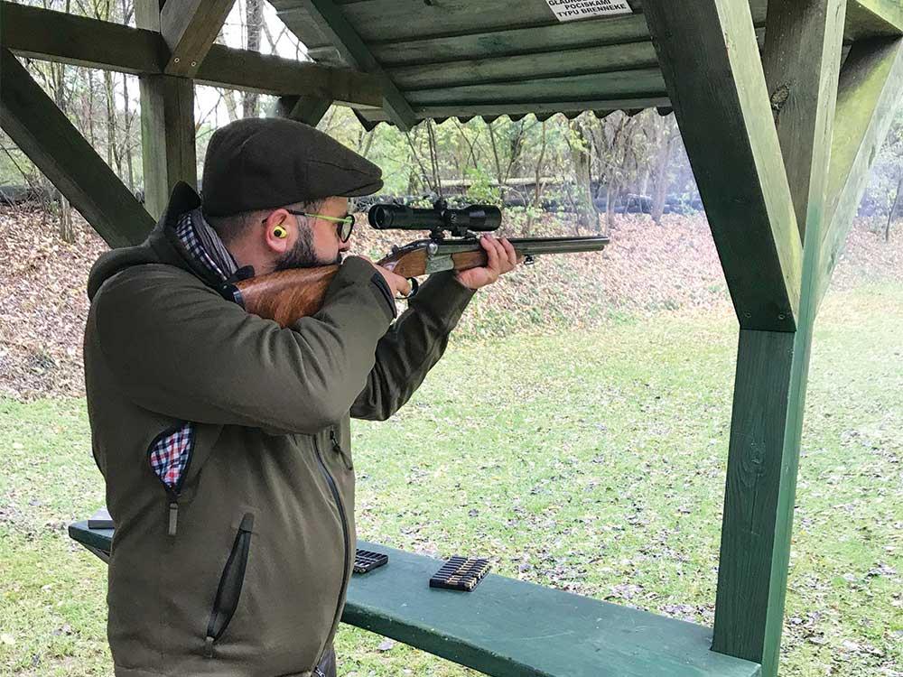 hunter aiming rifle at a shooting range