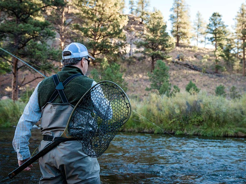 fly fisherman with net on back