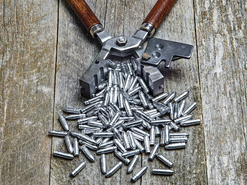 pile of 7mm rifle bullets freshly cast