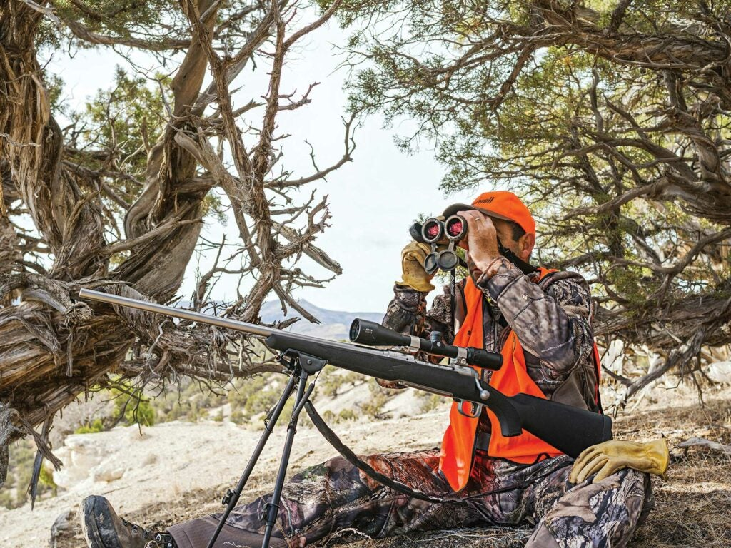 hunter with bipod, glassing