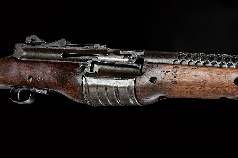 close up of 1941 johnson automatic service rifle rotary magazine