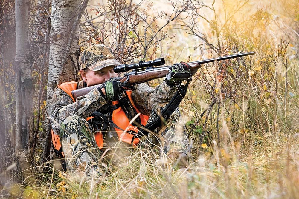 Montana Deer Hunter aiming with Scope