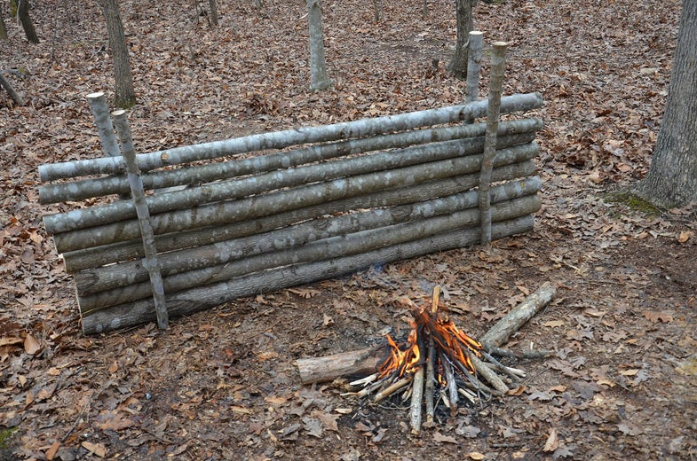 logs stacked by fire