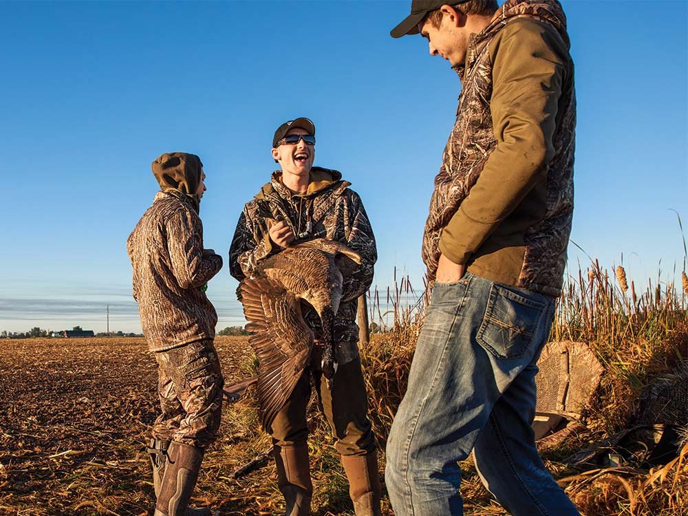 geese hunters with banded bird