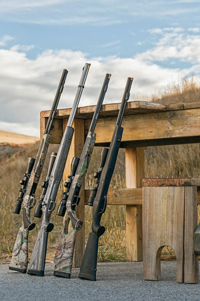 The test-fire lineup (from left): Traditions Vortek Strikerfire, Remington Ultimate Muzzleloader, CVA Accura V2, and T/C Strike.